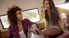 Girls talking on road trip Stock Footage