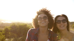 Girls laughing and walking ins slow motion Stock Footage