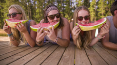 Friends eating watermelon Stock Footage