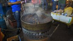 Kuala Lumpur Petaling street Chinatown night market roasted nuts Malaysia Asia Stock Footage