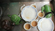 Stock Video Footage of Cups and Teapots Put Aside to be Rinsed and Re-Used