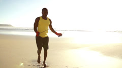 Man doing jumping rope at the beach Stock Footage