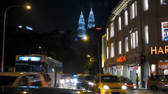 Time Lapse Busy Bustle Kuala Lumpur Downtown Traffic w PETRONAS Twin Towers Stock Footage