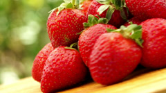 Spinning strawberries Stock Footage