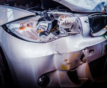 smashed luxury car - stock photo