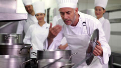Head chef smelling pot of soup making ok sign Stock Footage