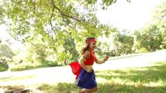 Running superhero girl Stock Footage