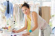 Stock Photo of Female fashion designer working on her designs