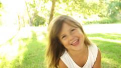 Little girl holding gummy bears Stock Footage