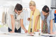 Stock Photo of Fashion designers discussing designs