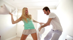 Couple fighting with pillows Stock Footage