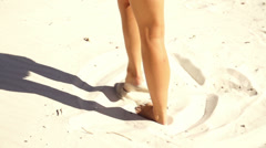Girl is barefoot at the beach Stock Footage