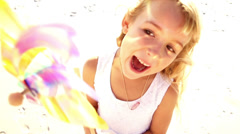 Smiling girl holding windmill - stock footage