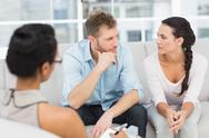 Stock Photo of Unhappy couple at therapy session