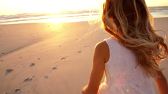Little girl is running towards sunset Stock Footage