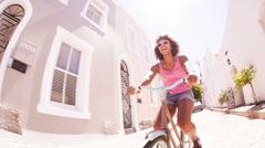 Girl riding a bike on the street Stock Footage