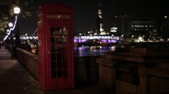 London telephone box, people walk by Stock Footage