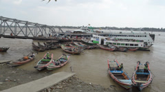 PORT, QUAY & JETTY:  ASIA - Pan across jetty of boats at port Stock Footage