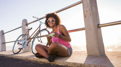 Girl with mobile phone near beach Stock Footage