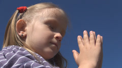 Little Girl Praying, Child with Eyes Closed Saying Prayer, Pensive Kid Portrait - stock footage