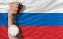 Silver medal for sport and  national flag of russia Stock Photos
