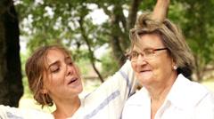 Grandma dancing her granddaughter - stock footage