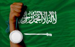 Silver medal for sport and  national flag of  of saudi arabia Stock Photos