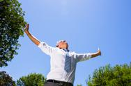 Stock Photo of Carefree businessman with arms outstretched
