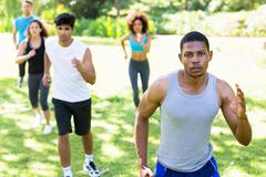 People running for fitness in the park - stock photo