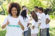 Stock Photo of Volunteer showing thumbs up