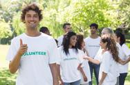 Stock Photo of Confident volunteer showing thumbs up