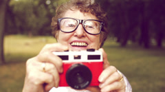 Grandma with retro camera Stock Footage