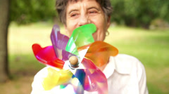 Senior woman with windmill Stock Footage