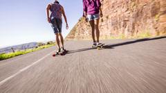 Couple on skateboard Stock Footage