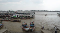 PORT, QUAY & JETTY:  ASIA - Passenger boat arrives in a small port in Burma Stock Footage