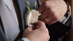 Man Going to a Wedding the Groom and Attaches Boutonniere - stock footage