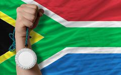 silver medal for sport and  national flag of south africa - stock photo