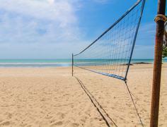 Beach volleyball net on a sunny day Stock Photos