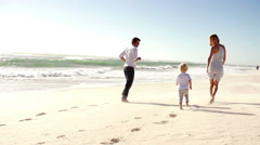 Family running at the beach Stock Footage