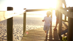 Father and son running on jetty - stock footage