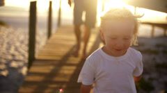 Father and son running on jetty Stock Footage