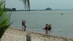 Thailand Ko Samui Island 067 tourists on a natural beach Stock Footage