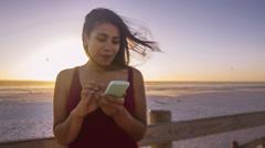 Teenage girl using mobile phone Stock Footage
