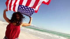 Serious woman with american flag Stock Footage