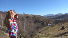 Little Girl Shading Eyes Looking at Mountains Landscape in Trip, Child's View Stock Footage
