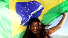 Brazilian girl with flag at the beach in slow motion - stock footage