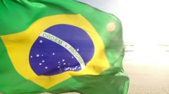Brazilian Flag waving in wind in slow motion - stock footage