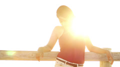 Young woman on beach boardwalk - stock footage