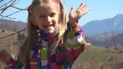 Child, Kid Waving Goodbye in Mountains, Portrait of Laughing Little Girl Playing Stock Footage