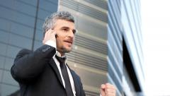 Successful business man talking at the phone Stock Footage
